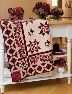 This Ruby Jubilee sampler quilt by Kim Diehl showcases a variety of rich red prints, with a sprinkling of classic quilt blocks within the Star blocks. Spectacular!