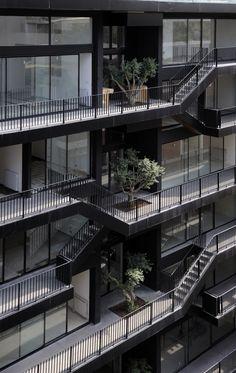 Half outdoor hallways/corridors.  Plot #183 / Bernard Khoury Architects (ArchDaily) http://www.archdaily.com/179287/plot-183-bernard-khoury-architects/