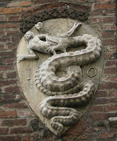 The Biscione: the coat of arms of the House of Visconti, from the Archbishops' palace in Piazza Duomo.