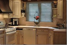 painting kitchen cabinets with Rust-Oleum Cabinet Transformation product