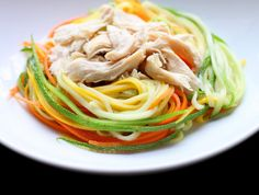 Zucchini Noodles with Chicken and Tangy Peanut Sauce - buying one of these handy peeling gadgets and trying this recipe asap.