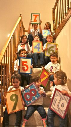 Omigosh, I LOVE this idea! Family photo idea for grandparents... all the grand kids holding their # in birth order.