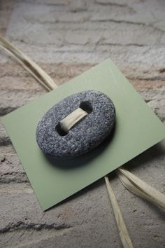 Button crafted from a beach stone. Beautiful!