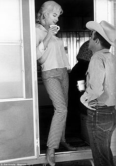 Coffee break: The actress stops at the door of her trailer to have a chat with co-star Montgomery Clift