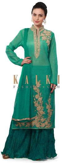 Buy Online from the link below. We ship worldwide (Free Shipping over US$100). Product SKU - 313068. Product Price - $129.00. Product link - http://www.kalkifashion.com/dark-green-straight-fit-suit-enhanced-in-zari-embroidered-neckline-only-on-kalki.html