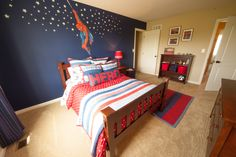 Spiderman inspired kids room by Tuskes Homes - love the dark wall and the bed which looks Spiderman'ish without being tacky.
