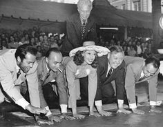 Rita Hayworth with Henry Fonda, Charles Boyer, Charles Laughton, Edward G. Robinson and Sid Grauman at Grauman's Chinese Theater - July 1942