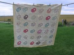 https://flic.kr/p/oBYhA | An Old, Old Quilt | A family heirloom?  Well, maybe...I bought it at Uncle Leo's auction back in 1997.  I was busy visiting at the auction when I saw the auctioneer hold this quilt up and start the bidding.  I bid once ($12), and got it!  I don't have much information on who made it or when, but the interesting part of this quilt is that the top has a cut edge.  Seems someone took a scissors and cut right down the center of a row of blocks!  WHY they would do that…