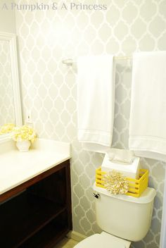 Yellow bathroom accents. Wallpaper may be a good idea for the kids...