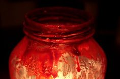 Materials:  Old spaghetti jar (cleaned, of course — I like Bertolli for their jars)  Modge Podge (or other gluey sealer; come to think of it, white glue would probably work fine)  A cheapy paint brush  Red food coloring or dark red paint  a tealight/small candle    I poured some of the modge podge into a disposable container and added quite a bit of food coloring (why? because I didn't have any red paint and the modge-podge ensured it would dry with an opaqueness that would look, well, a bit…