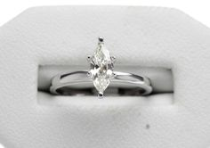14K White Gold  Sophisticated solitaire engagement ring with 1 Marquise cut diamond weighing 0.46ctw with a Color and Clarity of J/VS1. #engagementring #marquise #whitegold