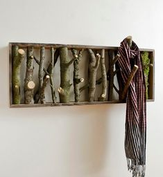 Beautiful rustic-looking DIY coat-hanger and/or wall art for the home...