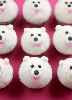 DIY Mini Polar Bear Cupcakes [Tutorial] : chocolate jimmies for the eyes + edible eyes for the nose + pink confetti sprinkles for the mouth + 8mm edible soft pearls for the ears... so easy!
