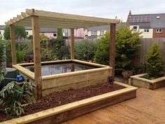 Railway sleeper pond, pergola and raised beds