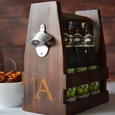 Stained, all-natural Fir wood carrier for 6 standard 12 ounce beer bottles. Features inclued sleek polished steel handle and hefty brushed zinc bottle…