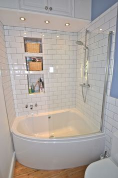 Simple White Small Bathroom Design With Corner Bath Tub and White Ceramic Tiles Walls and Glass Cabin Idea - Use J/K to navigate to previous and next images