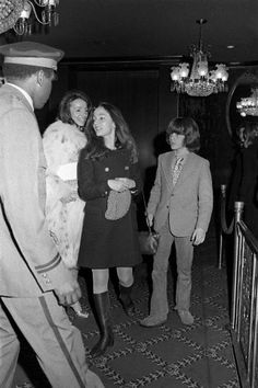 Lee Radziwill with daughter Anna Christina and John Kennedy Jr. at a screening of 'The Day of the Dolphin' at the Ziegfeld Theater, 1973