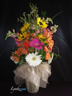 ceremony arrangement as a bouquet from sunflowers, gerbera daisy and snapdragons