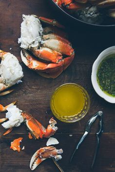 Cracked Crab recipe and my three favorite sauces for crab: Spicy Smoked Paprika Aioli, Herby Sauce Verte and Drawn Butter. I look forward to this holiday meal all year. Perfect for Christmas or New Year's Eve!