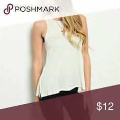 Cream top Cute cream tank top! Flowing on the bottom. Awesome tank! Lila Clothing Co. Tops Tank Tops