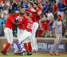 Teammates mob Ian Desmond after his ninth-inning single gave the Rangers the winning run vs. the Angels Monday, September 19, 2016. (Louis DeLuca/The Dallas Morning News)
