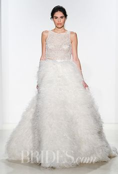 Brides.com: . A-line wedding dress with illusion bodice and feather skirt, Kelly Faetanini