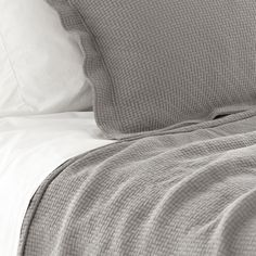 interlaken matelasse coverlet (fieldstone) from Thos. Baker Like the texture...not the price! This is a lighter gray.