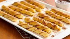 Baked Crescent Churros - unroll crescent rolls, separate into 4 rectangles. Connect seams of 2 triangles. Cut into strips, coat with cinnamon sugar, twist, bake according to instructions. Serve with chocolate sauce. Can also make cheese twists following a similar method except sprinkle with parmesan cheese & parsley.