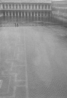 Piazza St. Marco in the Rain l Italian Landscape and People, 1950s photo by Gianni Berengo Gardin