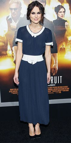 Keira Knightley arrived at the Los Angeles premiere of Jack Ryan: Shadow Recruit in a demure white-and-navy Chanel dress with bow accents, pairing it with classic black pumps.
