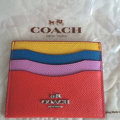 Coach card holder. Coach color block card holder. Silver embossed logo. 4 pockets. Comes with care card and price tag. Coach Accessories Key & Card Holders
