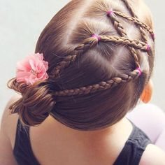 Criss-crossed braids into a side bun for dance.