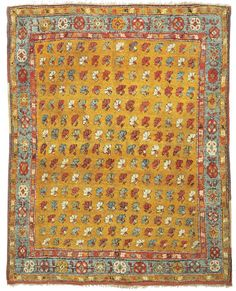 """Alberto Levi Gallery  Yatak with stylised carnations Çal area, Menderes Valley Southwest Anatolia circa 1830 191 x 160 cm (6'3"""" x 5'3"""")  From the Turkish word for 'bed', yatak rugs are typically woven in a squarish format with a low knot count, having loosely spun, silky long piled wool on a foundation characterised by a number of weft shoots."""