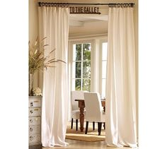 floor to ceiling curtains, never thought about using a twin flat sheet. BRILLIANT!