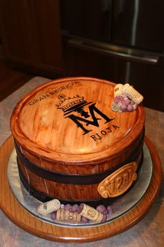 """Wine Barrel Anniversary Cake 3 layer rounds covered in fondant """"wood slats"""" with handpainted winery stamp on top. Birthday Cake Wine, 50th Birthday Cakes For Men, Themed Birthday Cakes, Themed Cakes, 60 Birthday, Whiskey Barrel Cake, Whiskey Cake, Wine Bottle Cake, Cake Design For Men"""
