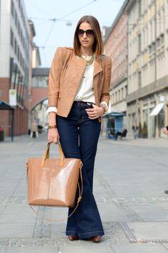 Jacket, bag, wide leg trouser jeans.