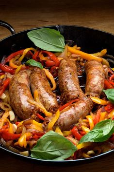 NYT Cooking: For an easy, hearty dinner (or breakfast or lunch) buy fresh Italian pork fennel sausages, preferably from an Italian deli or butcher. Pair them with quickly stewed peppers and onions, splashed with vinegar, and fried eggs. Onion Recipes, Sausage Recipes, Pork Recipes, Cooking Recipes, Meatball Recipes, Quail Recipes, Easy Recipes, Sausage Peppers And Onions, Stuffed Peppers