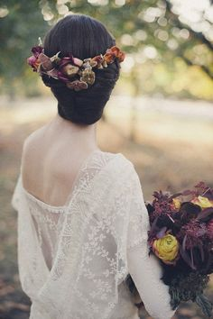 This bride wore a crown of velvet flowers in rich autumnal hues. She designed her own dress, made of lace and silk, in collaboration with couturier Martina Trottmann.   Photo by Rik Pennington