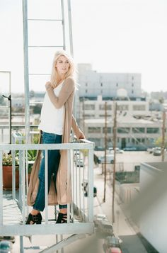 Taking full advantage of the balcony on a nice Fall day.   Model @abbyplunk wearing our Duster Cardigan Photo: @eslee
