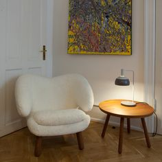 Pelican Chair and pelican Table and Table Lamp designed by Finn Juhl and produced by Onecollection.
