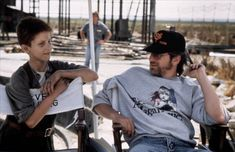 Christian Bale and Steven Spielberg on the set of Empire of the Sun (1987)