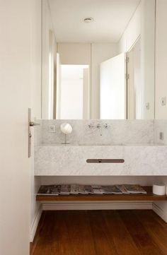 Long marble vanity for our renovation that goes wall to wall.  Nix the weird hole and magazines on shelf.