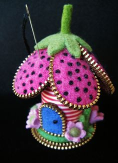 https://flic.kr/p/a4abXp | My little striped spool flower pincushion | The striped spool is full... sadly the thread is unusable. I have quite a large collection of these spools, now I think I know what I'll do with them!!