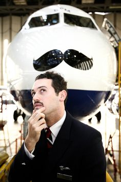Reminds me of your brother!              The big picture: BA supports 'Movember' with A319 moustache - Business Traveller