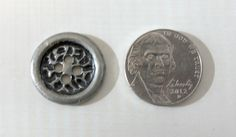 6 silver buttons with pitted design. $10.00 USD