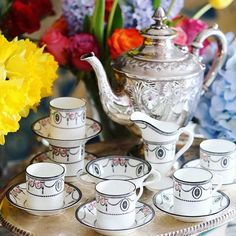 A lovely Royal Doulton coffee set matched with antique silver plated teapot and tray. The black and white swag and pink roses are so romantic and rococo. These 1920s saucers have a deep well design to keep your cup on it stable and safe. A tall milk jug and double handle sugar bowl makes it more elegant and unique.