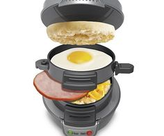 Mornings will never be the same once the ultimate breakfast machine enters your life. In just five minutes this glorious machine will make you a complete breakfast sandwich. It's the delicious and cost effective way to clog your arteries from the comfort of home.