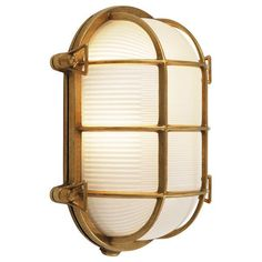 "Nautical Oval Outdoor Sconce This nautically themed outdoor sconce is comprised of an etched glass diffuser placed within an ovular metal guard. Available in Chrome and Polished Brass finishes. 60 watt medium base bulb max. (10.5""Hx8""Wx6""E)"