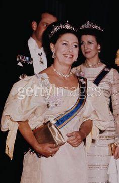 Princess Margaret wearing the Lotus tiara and Princess Alexandra wearing the pearl version of her floral tiara