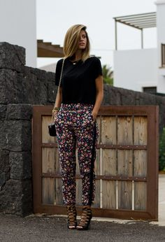 I love these patterned pants with the simple black shirt! And you could wear flats or heels to dress it up :)